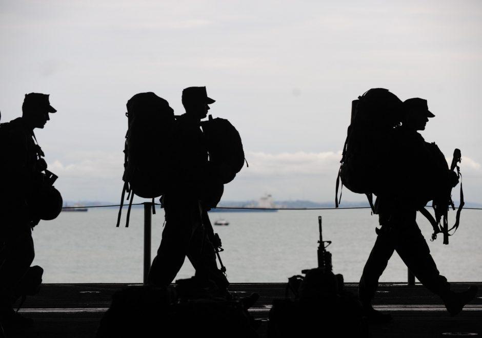 three men carrying